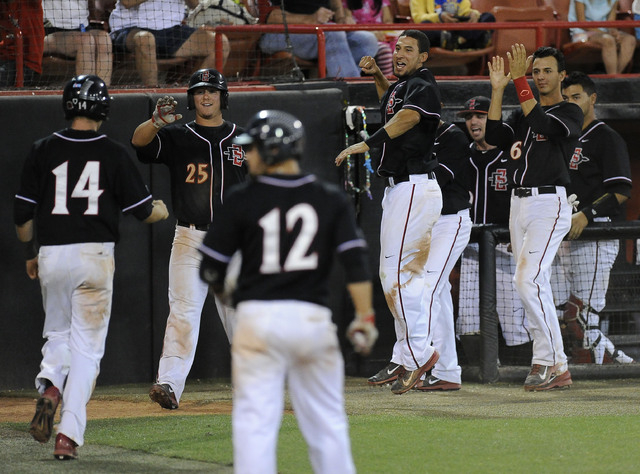 The San Diego State dugout reacts after outfielder Greg Allen drove in two runs in the fourth inning of the 2014 Mountain West Conference Baseball Championship game  between the UNLV Rebels at Ear ...