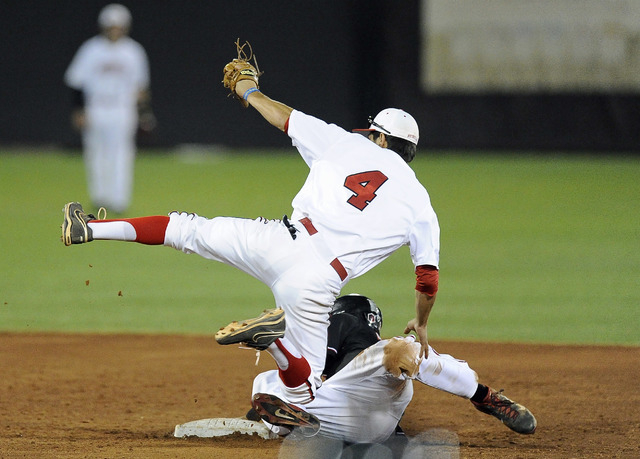 UNLV shortstop Matt McCallister  tags out San Diego State outfielder Seby Zavala after Zavala tried to steal secon base in the fith inning of the 2014 Mountain West Conference Baseball Championshi ...