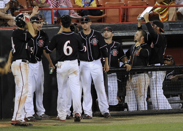 The San Diego State dugout reacts after the Aztecs score a run in the fith inning of the 2014 Mountain West Conference Baseball Championship game between the UNLV Rebels at Earl E. Wilson Stadium  ...