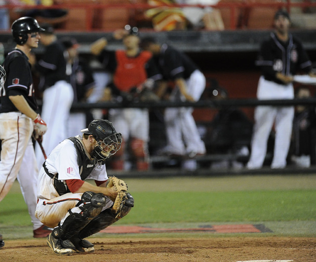 UNLV catcher Erik VanMeetren reacts reacts after the San Diego State Aztecs scored a run in the fith inning of the 2014 Mountain West Conference Baseball Championship game at Earl E. Wilson Stadiu ...
