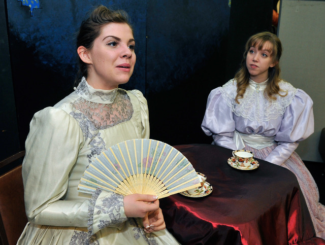 """Abby Dandy, left, as Gwendolen Fairfax and Tara Thompson as Cecily Cardew perform during a rehearsal of Oscar Wilde's """"The Importance of Being Earnest"""" at the Onyx Theatre on Monday, May 12, 2014. ..."""