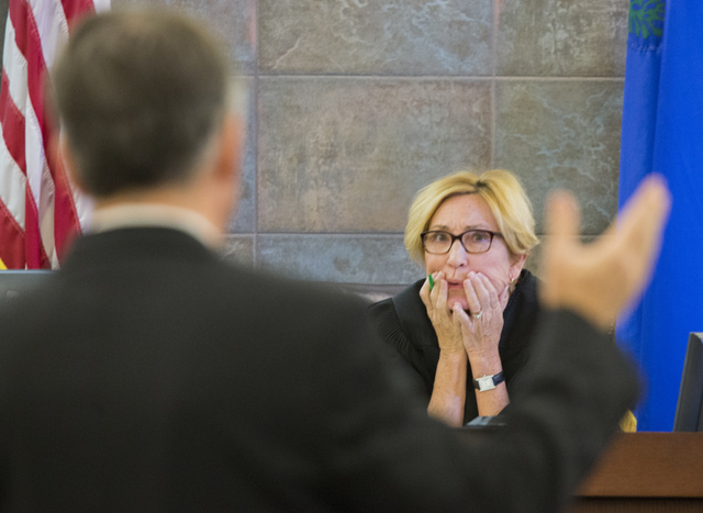 Judge Kerry Earley listens to defense attorney Daniel Polsenberg at the Regional Justice Center on April 7. (Jeff Scheid/Las Vegas Review-Journal)