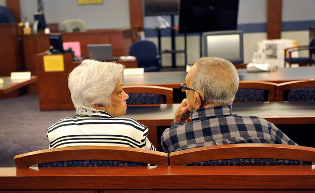 Las Vegas resident Bertha Triana, left, sits with her husband, Hiram Triana, before the verdict was read in her civil suit against against Japanese drug maker Takeda Pharmaceuticals at the Regiona ...