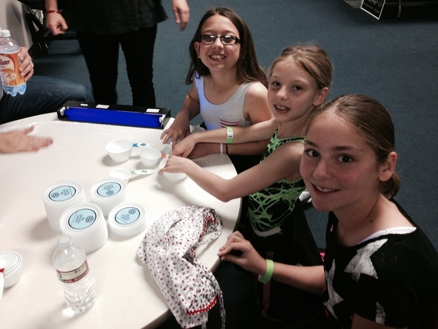 Adelson Educational Campus students, clockwise, sixth-grader Devin Woodrow, second-grader Brinkley Woodrow and sixth-grader Allison Stone learn new things in the Dark Domain with ThinkerTinkers du ...