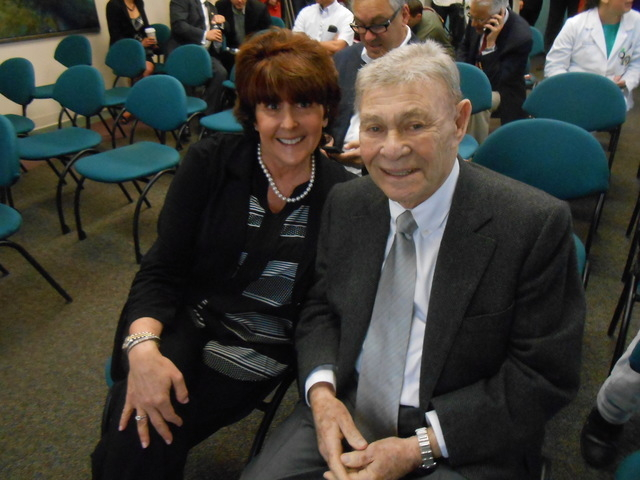 Irwin Molasky, 86, sits with Carole Fisher, president and CEO of Nathan Adelson Hospice, April 9 at a Nathan Adelson press conference announcing that the American Osteopathic Association has appro ...