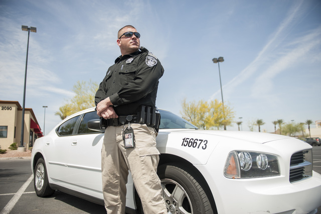 Security officer Jeremy Brumbaugh looks over a scene in Las Vegas on Friday, May 9, 2014. Brumbaugh is a member of the Unity One, Inc security team which hopes to work with medical marijuana busin ...
