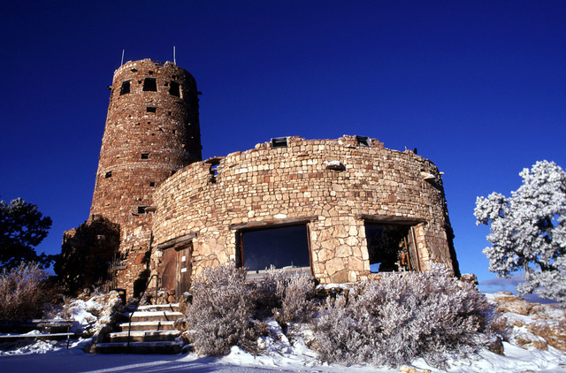 Snow surrounds the Grand Canyon's Desert View Watchtower in Grand Canyon National Park in Arizona. (AP File Photo/Jason Wise)