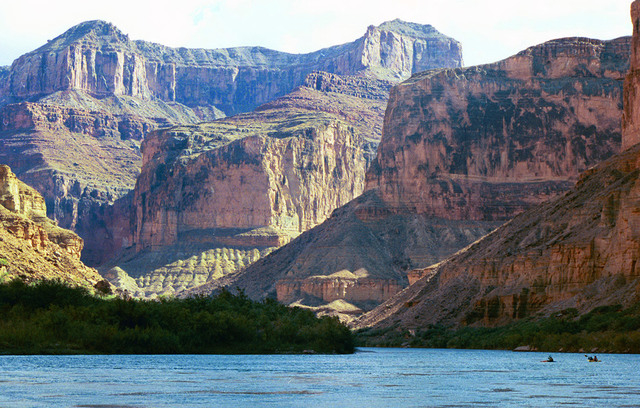 Kayakers glide through the Colorado River near Grand Canyon National Park as the canyon's walls rise up hundreds of feet around them.  (AP File Photo/Brian Witte)
