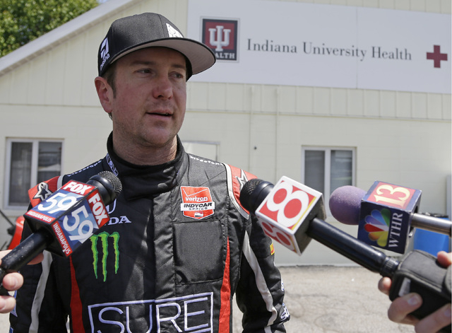 Kurt Busch is interviewed as he leaves the track medical center after he crashed in the second turn during practice for the Indianapolis 500 IndyCar auto race at the Indianapolis Motor Speedway on ...