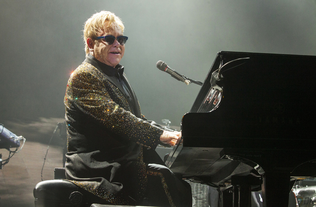 Sir Elton John performs at the Allstate Arena in Rosemont, Ill in this file photo. This year's Bonnaroo Music and Arts Festival lineup includes John and Kanye West. The four-day event begins June  ...