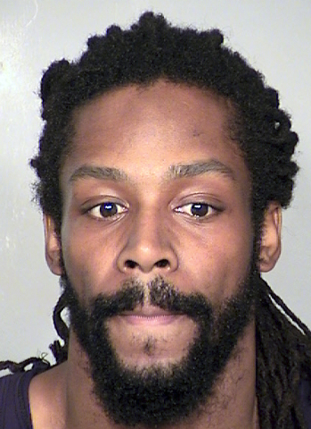 This image provided by the Clark County Detention Center shows Kirk Bills, who has been accused of trying to burn a pet shop where 27 puppies were rescued last month.  Bills has been returned in c ...