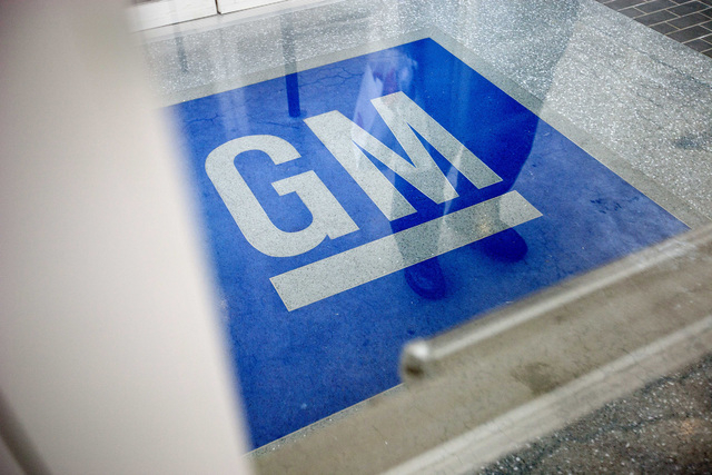 The logo for General Motors decorates the entrance at the site of a GM information technology center in Roswell, Ga., in this Jan. 10, 2013 photo. (AP Photo/David Goldman, File)
