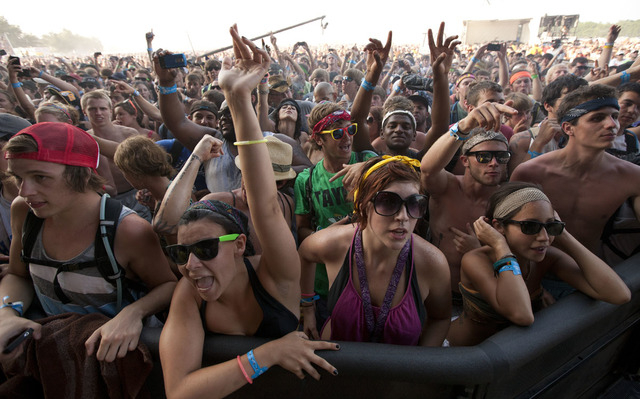 This file photo shows music fans gathering during the Bonnaroo Music and Arts Festival in Manchester, Tenn. Despite heat, humidity, crowds and costs, music festivals are more popular than ever, at ...