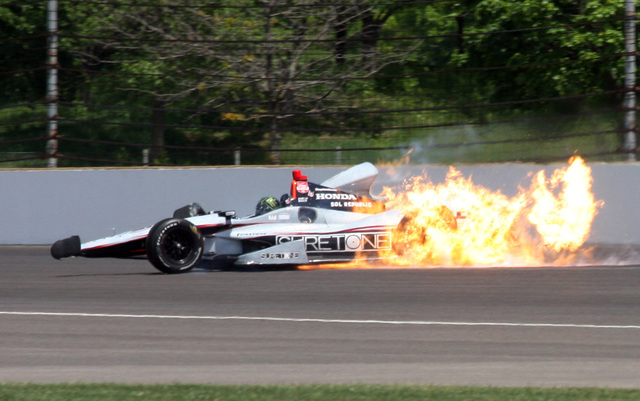 The car driven by Kurt Busch catches fire after hitting the wall in the second turn during practice for the Indianapolis 500 IndyCar auto race at the Indianapolis Motor Speedway on Monday. (AP Pho ...