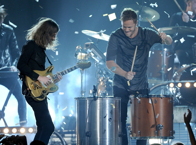 Wayne Sermon, left, and Dan Reynolds, of the musical group Imagine Dragons, perform at the Billboard Music Awards at the MGM Grand Garden Arena on Sunday, May 18, 2014, in Las Vegas. (Photo by Chr ...