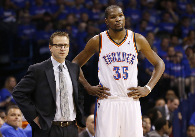 Oklahoma City Thunder head coach Scott Brooks, left, and forward Kevin Durant, right, watch during a foul shot by the Los Angeles Clippers in the third quarter of Game 1 of the Western Conference  ...