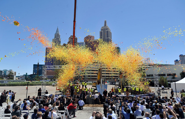 Confetti is launched during a ceremonial ground breaking event for new MGM Resorts International and AEG joint venture indoor arena located behind the New York-New York hotel-casino on Thursday, M ...