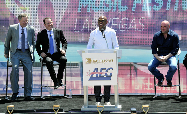 Boxer Floyd Mayweather Jr., speaks as Jim Murren, chairmen CEO MGM Resorts International, left, Dan Beckerman, president and CEO AEG and Dana White, president of UFC listen during a ceremonial gro ...