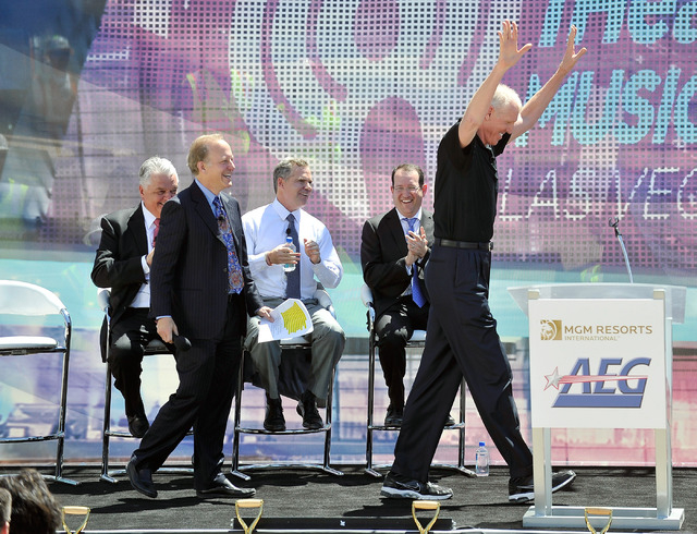 Bill Walton, right, sportscaster and former NBA player finishes his speech with his hands raised as as Jim Gray looks on during a ceremonial ground breaking event for new MGM Resorts International ...