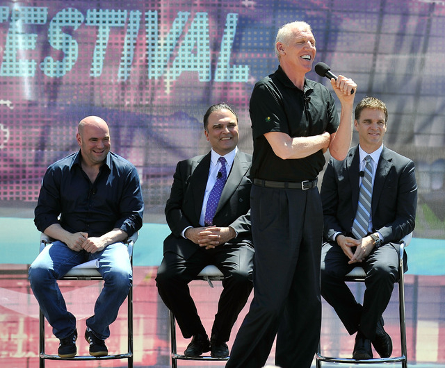 Bill Walton, second from right, sportscaster and former NBA player speaks as Dana White, left, president of UFC; Richard Shafer, CEO Golden Boy Boxing; and Luke Robitaille, president of business o ...