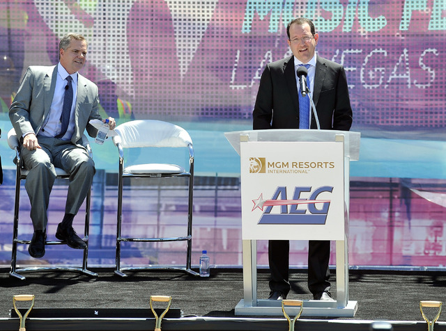 Dan Beckerman, right, president and CEO of AEG speaks as Jim Murren, chairmen and CEO MGM Resorts International looks on during a ceremonial ground breaking event for new MGM Resorts International ...