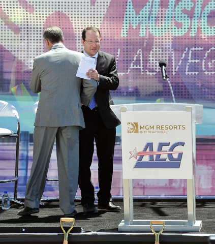 Dan Beckerman, right, president and CEO of AEG and Jim Murren, chairmen and CEO MGM Resorts International shake hands as the two pass on stage during a ceremonial ground breaking event for new MGM ...
