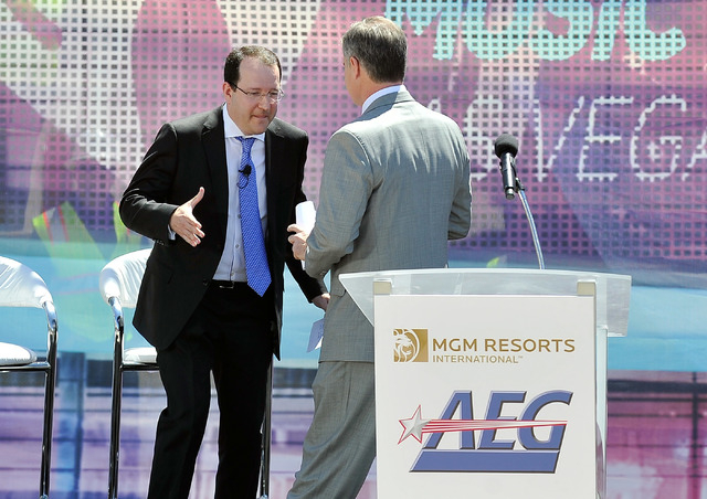 Dan Beckerman, left, president and CEO of AEG and Jim Murren, chairmen and CEO MGM Resorts International shake hands as the two pass on stage during a ceremonial ground breaking event for new MGM  ...