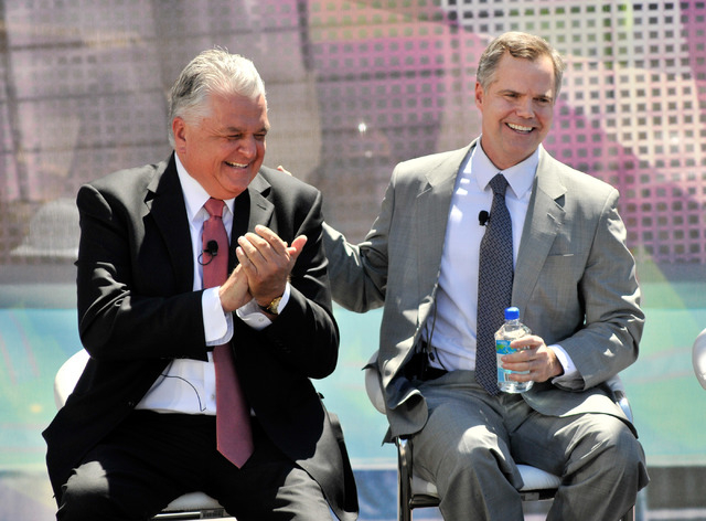 Steve Sisolak, left, Clark County commissioner and Jim Murren, chairmen and CEO of MGM Resorts International applaud during a ceremonial ground breaking event for new MGM Resorts International and ...