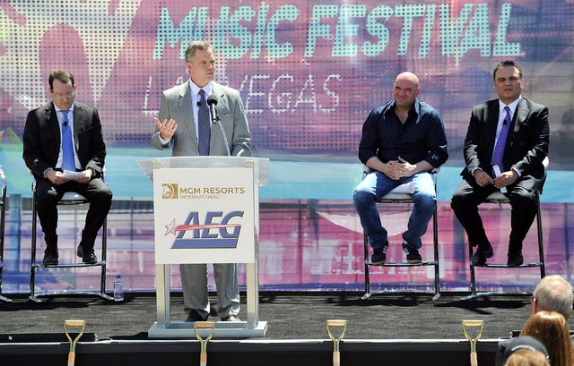 Jim Murren, second left, chairmen and CEO of MGM Resorts International speaks during a ceremonial ground breaking event for new MGM Resorts International and AEG joint venture indoor arena located ...