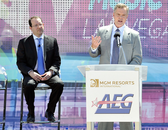 Jim Murren, right, chairmen and CEO of MGM Resorts International speaks as Dan Beckerman, president and CEO for AEG looks on during a ceremonial ground breaking event for new MGM Resorts Internati ...