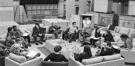 This Tuesday, April 29, 2014 photo provided by Lucasfilm shows Star Wars writer/director/producer J.J. Abrams, rear center, at the cast read-through of Star Wars: Episode VII at Pinewood Studios n ...