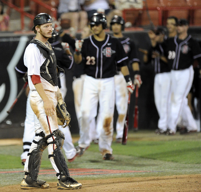 UNLV catcher Erik VanMeetren reacts after the San Diego State Aztecs scored a run in the sixth inning of the 2014 Mountain West Conference Baseball Championship game at Earl E. Wilson Stadium in L ...