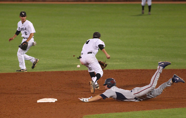 Fresno State's Jordan Luplow jumps to slide safely into second base as UNLV's Justin Jones (2) and Matt McCallister (4) miss the throw in the fifth inning during a game in the Mountain West baseba ...