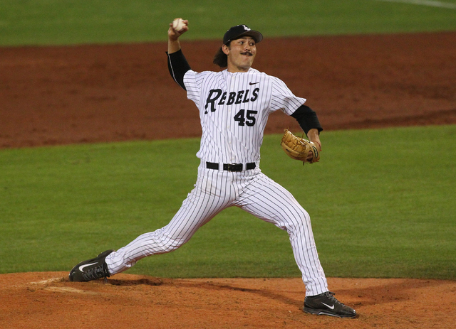 UNLV's John Richy fires a pitch to Fresno State in the fourth inning during a game in the Mountain West baseball tournament at Earl E. Wilson Stadium in Las Vegas on Thursday, May 22, 2014. (Chase ...