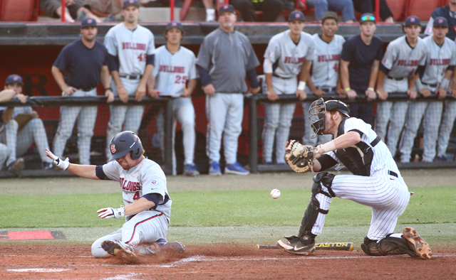 Fresno State's Jordan Luplow (4) slides safely into home plate as UNLV catcher Erik VanMeetren loses control of the ball in the first inning during a game in the Mountain West baseball tournament  ...