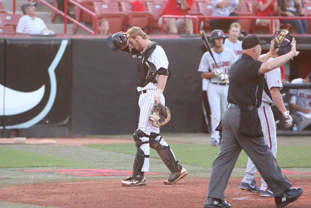 UNLV catcher Erik VanMeetren reacts after failing to tag out Fresno State's Jordan Luplow (4) at home plate in the first inning during a game in the Mountain West baseball tournament at Earl E. Wi ...