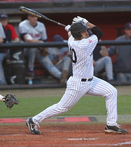 UNLV's T.J. White hits a double against Fresno State in the first inning during a game in the Mountain West baseball tournament at Earl E. Wilson Stadium in Las Vegas on Thursday, May 22, 2014. (C ...