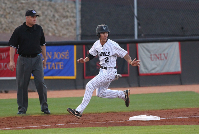 UNLV's Justin Jones (2) looks back after arriving safely at third base while playing against Fresno State in the first inning during a game in the Mountain West baseball tournament at Earl E. Wils ...