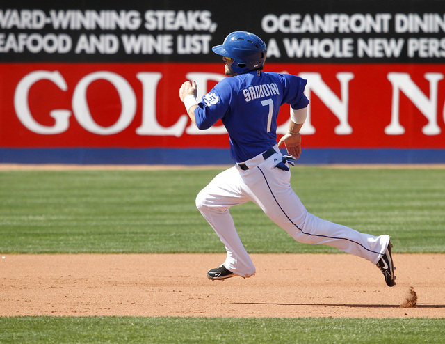 Las Vegas 51s shortstop Rylan Sandoval rounds second base on his way to scoring against the  Tacoma Rainiers in the sixth inning of their game at Cashman Field on Sunday, May 11, 2014 in Las Vegas ...