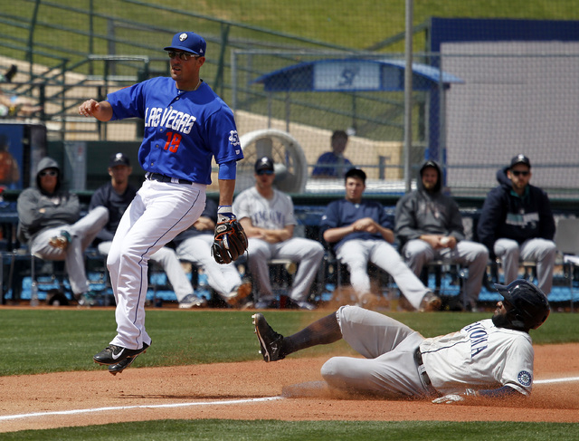 Las Vegas 51s third baseman Zach Lutz avoids the slide  by Tacoma Rainiers s outfielder Abraham Almonte during their game at Cashman Field on Sunday, May 11, 2014 in Las Vegas. (Justin Yurkanin/La ...