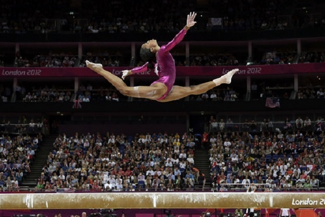 U.S. gymnast Gabrielle Douglas performs on the balance beam during the artistic gymnastics women's individual all-around competition at the 2012 Summer Olympics, Thursday, Aug. 2, 2012, in Londo ...