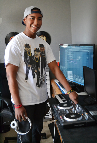"""Andamo Hondo, otherwise known as """"Beat Rokka"""", poses for a portrait with his DJ equipment in his home in Henderson on April 5, 2014. (Paige Malik/Las Vegas Review-Journal)"""