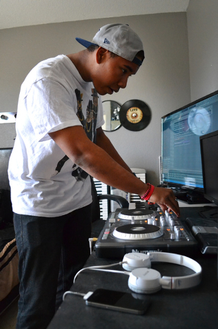 """Andamo Hondo, otherwise known as """"Beat Rokka"""", practices his DJ skills in his home in Henderson on April 5, 2014. (Paige Malik/Las Vegas Review-Journal)"""