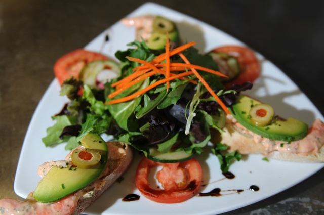 Shrimp and avocado on tartine baguette is seen served with salad and remoulade dressing at Bernard's Bistro in Henderson, Nev., Saturday, May 17, 2014. (Erik Verduzco/Las Vegas Review-Journal)