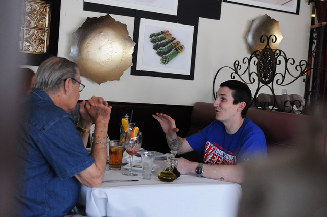 Erik Bukofsky, right, dines with his father Leonard and mother Billie Jean at Bernard's Bistro in Henderson, Nev., Saturday, May 17, 2014. (Erik Verduzco/Las Vegas Review-Journal)