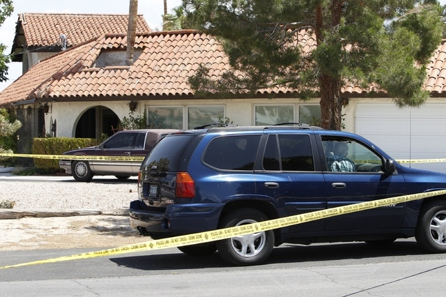 Police investigate a home where a dead body was found at 2841 E. Florence Lane in Las Vegas Tuesday, May 6, 2014. (John Locher/Las Vegas Review-Journal)