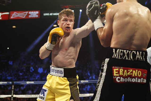 Saul Canelo Alvarez takes on Alfredo Angulo during their Super Welterweight fight at the MGM Grand Garden Arena in Las Vegas on March 8. (Jason Bean/Las Vegas Review-Journal)