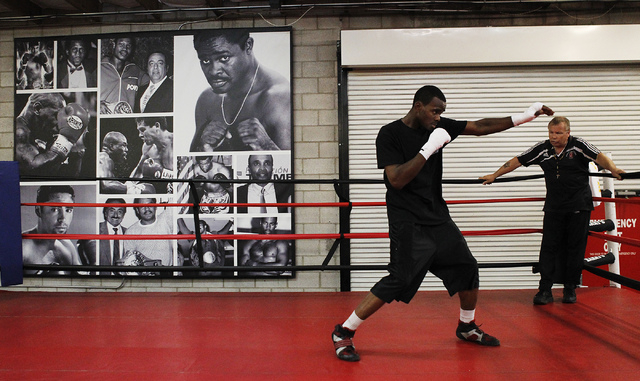 Local super middleweight boxer Jamie Swanson works out with his trainer Pat Berry for the upcoming National Golden Gloves tournament at Barry's Boxing Center in Las Vegas on May 8, 2014. (Jason Be ...