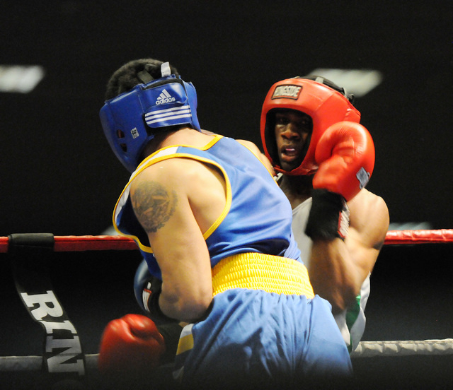 Eric Altamirano, left, boxes Jaron Ennis during the Golden Gloves Tournament of Champions at the LVH casino-hotel in Las Vegas Wednesday, May 14, 2014. (Erik Verduzco/Las Vegas Review-Journal)