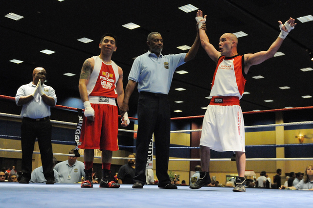 Dylan Henry, right, reacts as he is declared the winner during his match against Lorenzo Rosales during the Golden Gloves Tournament of Champions at the LVH casino-hotel in Las Vegas Wednesday, Ma ...
